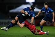 16 October 2021; Caelan Doris of Leinster is tackled by Tomas Lezana of Scarlets during the United Rugby Championship match between Leinster and Scarlets at the RDS Arena in Dublin. Photo by Harry Murphy/Sportsfile