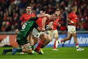 16 October 2021; John Ryan of Munster is tackled by Cian Prendergast, left, and Sammy Arnold of Connacht during the United Rugby Championship match between Munster and Connacht at Thomond Park in Limerick. Photo by Piaras Ó Mídheach/Sportsfile