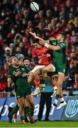 16 October 2021; Tiernan O'Halloran of Connacht contests possession against Munster players Joey Carbery and Simon Zebo, behind, during the United Rugby Championship match between Munster and Connacht at Thomond Park in Limerick. Photo by Piaras Ó Mídheach/Sportsfile
