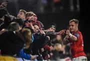 16 October 2021; Craig Casey of Munster with supporters after the United Rugby Championship match between Munster and Connacht at Thomond Park in Limerick. Photo by David Fitzgerald/Sportsfile