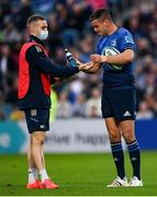 16 October 2021; Jonathan Sexton of Leinster with acting water carrier Nick McCarthy during the United Rugby Championship match between Leinster and Scarlets at the RDS Arena in Dublin. Photo by Harry Murphy/Sportsfile