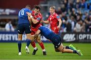 16 October 2021; Ryan Conbeer of Scarlets is tackled by Jonathan Sexton, left, and Josh van der Flier of Leinster during the United Rugby Championship match between Leinster and Scarlets at the RDS Arena in Dublin. Photo by Seb Daly/Sportsfile