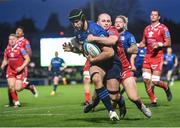 16 October 2021; Caelan Doris of Leinster is tackled by Scarlets' Ioan Nicholas on his way to scoring his side's fourth try during the United Rugby Championship match between Leinster and Scarlets at the RDS Arena in Dublin. Photo by Seb Daly/Sportsfile
