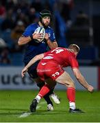 16 October 2021; Caelan Doris of Leinster in action against Johnny McNicholl of Scarlets during the United Rugby Championship match between Leinster and Scarlets at the RDS Arena in Dublin. Photo by Seb Daly/Sportsfile