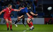 16 October 2021; Caelan Doris of Leinster is tackled by Johnny McNicholl of Scarlets during the United Rugby Championship match between Leinster and Scarlets at the RDS Arena in Dublin. Photo by Seb Daly/Sportsfile