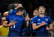 16 October 2021; Dan Sheehan of Leinster, hidden, is congratulated by team-mates Ryan Baird and Luke McGrath after scoring their side's seventh try during the United Rugby Championship match between Leinster and Scarlets at the RDS Arena in Dublin. Photo by Seb Daly/Sportsfile