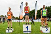 17 October 2021; On the podium after the Junior Men's 6000m race are, first place Nicholas Griggs of Mid Ulster AC, Derry, second place Scott Fagan of Metro/St Brigid's AC, Clare, and third place Aaron Smith of Cilles AC, Meath, during the Autumn Open International Cross Country at the Sport Ireland Campus in Dublin. Photo by Sam Barnes/Sportsfile