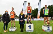 17 October 2021; On the podium after the Junior Men's 6000m race are, first place Nicholas Griggs of Mid Ulster AC, Derry, second place Scott Fagan of Metro/St Brigid's AC, Clare, and third place Aaron Smith of Cilles AC, Meath, with Brid Golden, Deputy President, Athletics Ireland, and Seána Ó Rodaigh, Mayor of Fingal, during the Autumn Open International Cross Country at the Sport Ireland Campus in Dublin. Photo by Sam Barnes/Sportsfile