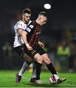 15 October 2021; Michael Duffy of Dundalk and Andy Lyons of Bohemians during the SSE Airtricity League Premier Division match between Bohemians and Dundalk at Dalymount Park in Dublin. Photo by Ben McShane/Sportsfile