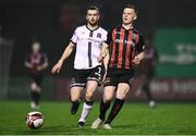 15 October 2021; Andy Lyons of Bohemians and Michael Duffy of Dundalk during the SSE Airtricity League Premier Division match between Bohemians and Dundalk at Dalymount Park in Dublin. Photo by Ben McShane/Sportsfile