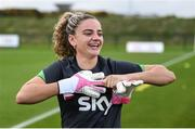 18 October 2021; Leanne Kiernan tries on the goalkeeping gloves of Courtney Brosnan during a Republic of Ireland training session at the FAI National Training Centre in Abbotstown, Dublin. Photo by Stephen McCarthy/Sportsfile