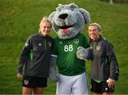 19 October 2021; Saoirse Noonan, left, and Savannah McCarthy meet Macúl, the official FAI mascot, before a Republic of Ireland training session at the FAI National Training Centre in Abbotstown, Dublin. Photo by Stephen McCarthy/Sportsfile