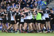 22 October 2021; Paddy Taylor of Newbridge College, centre, celebrates after his side's victory in the Bank of Ireland Leinster Schools Junior Cup Final match between Blackrock College and Newbridge College at Energia Park in Dublin. Photo by Piaras Ó Mídheach/Sportsfile