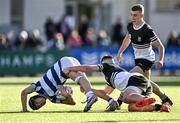 22 October 2021; Hubie McCarthy of Blackrock College is tackled by Billy Bohan of Newbridge College during the Bank of Ireland Leinster Schools Junior Cup Final match between Blackrock College and Newbridge College at Energia Park in Dublin. Photo by Piaras Ó Mídheach/Sportsfile