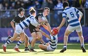 22 October 2021; Paddy Taylor of Newbridge College is tackled by Seb Shortt, left, and Charlie Woodcock of Blackrock College during the Bank of Ireland Leinster Schools Junior Cup Final match between Blackrock College and Newbridge College at Energia Park in Dublin. Photo by Piaras Ó Mídheach/Sportsfile