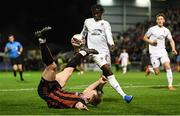 22 October 2021; Ciarán Kelly of Bohemians in action against Junior Quitirna of Waterford during the Extra.ie FAI Cup Semi-Final match between Bohemians and Waterford at Dalymount Park in Dublin. Photo by Stephen McCarthy/Sportsfile