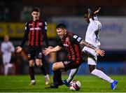 22 October 2021; Rob Cornwall of Bohemians in action against Junior Quitirna of Waterford during the Extra.ie FAI Cup Semi-Final match between Bohemians and Waterford at Dalymount Park in Dublin. Photo by Eóin Noonan/Sportsfile