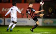 22 October 2021; Rob Cornwall of Bohemians in action against Junior Quitirna of Waterford during the Extra.ie FAI Cup Semi-Final match between Bohemians and Waterford at Dalymount Park in Dublin. Photo by Stephen McCarthy/Sportsfile