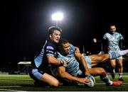 22 October 2021; Adam Byrne of Leinster scores his side's third try despite the tackle of Sam Johnson of Glasgow Warriors during the United Rugby Championship match between Glasgow Warriors and Leinster at Scotstoun Stadium in Glasgow, Scotland. Photo by Harry Murphy/Sportsfile