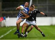 23 October 2021; Brian Kane of Naas is tackled by Danny O'Sullivan of Maynooth during the Kildare County Senior Club Football Championship Semi-Final match between Naas and Maynooth at St Conleth's Park in Newbridge, Kildare. Photo by Harry Murphy/Sportsfile