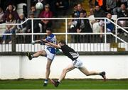 23 October 2021; Eamonn Callaghan of Naas scores a point under pressure from Callum McCabe of Maynooth during the Kildare County Senior Club Football Championship Semi-Final match between Naas and Maynooth at St Conleth's Park in Newbridge, Kildare. Photo by Harry Murphy/Sportsfile