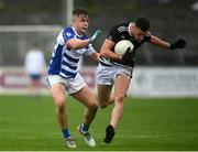 23 October 2021; Ruadhan O'Giollan of Maynooth in action against Tom Browne of Naas during the Kildare County Senior Club Football Championship Semi-Final match between Naas and Maynooth at St Conleth's Park in Newbridge, Kildare. Photo by Harry Murphy/Sportsfile