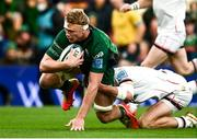 23 October 2021; Niall Murray of Connacht goes over to score his side's first try despite the attempted tackle from Ethan McIlroy of Ulster during the United Rugby Championship match between Connacht and Ulster at Aviva Stadium in Dublin. Photo by David Fitzgerald/Sportsfile