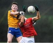 23 October 2021; Jason Gibbons of Ballintubber in action against Connell Dempsey of Knockmore during the Mayo County Senior Club Football Championship Quarter-Final match between Ballintubber and Knockmore at Connacht GAA Centre in Bekan, Mayo. Photo by Matt Browne/Sportsfile