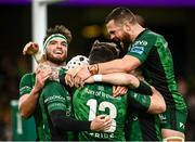 23 October 2021; Mack Hansen of Connacht second from left is congratulated by team-mates after scoring his side's second try during the United Rugby Championship match between Connacht and Ulster at Aviva Stadium in Dublin. Photo by David Fitzgerald/Sportsfile