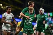 23 October 2021; John Porch of Connacht celebrates with team-mates Conor Fitzgerald and Mack Hansen after scoring their side's third try during the United Rugby Championship match between Connacht and Ulster at Aviva Stadium in Dublin. Photo by Brendan Moran/Sportsfile