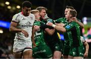 23 October 2021; John Porch of Connacht celebrates with team-mates Conor Fitzgerald, Mack Hansen and Kieron Marmion after scoring their side's third try during the United Rugby Championship match between Connacht and Ulster at Aviva Stadium in Dublin. Photo by Brendan Moran/Sportsfile