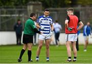 23 October 2021; Nass captain Eamonn Callaghan watches referee Niall Colgan toss the coin before the Kildare County Senior Club Football Championship Semi-Final match between Naas and Maynooth at St Conleth's Park in Newbridge, Kildare. Photo by Harry Murphy/Sportsfile