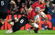 23 October 2021; Fineen Wycherley of Munster is tackled by Sam Cross of Ospreys during the United Rugby Championship match between Ospreys and Munster at Liberty Stadium in Swansea, Wales. Photo by Ben Evans/Sportsfile