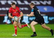 23 October 2021; Liam Coombes of Munster in action against Keiran Williams of Ospreys during the United Rugby Championship match between Ospreys and Munster at Liberty Stadium in Swansea, Wales. Photo by Gruffydd Thomas/Sportsfile