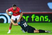 23 October 2021; Damian de Allende of Munster is tackled by Max Nagy of Ospreys during the United Rugby Championship match between Ospreys and Munster at Liberty Stadium in Swansea, Wales. Photo by Gruffydd Thomas/Sportsfile
