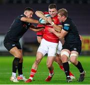 23 October 2021; Shane Daly of Munster is tackled by Owen Watkin and Jac Morgan of Ospreys during the United Rugby Championship match between Ospreys and Munster at Liberty Stadium in Swansea, Wales. Photo by Gruffydd Thomas/Sportsfile