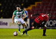 23 October 2021; Richie Towell of Shamrock Rovers in action against Aaron Robinson of Longford Town during the SSE Airtricity League Premier Division match between Longford Town and Shamrock Rovers at Bishopsgate in Longford. Photo by Seb Daly/Sportsfile