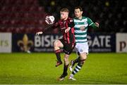 23 October 2021; Aodh Dervin of Longford Town in action against Chris McCann of Shamrock Rovers during the SSE Airtricity League Premier Division match between Longford Town and Shamrock Rovers at Bishopsgate in Longford. Photo by Seb Daly/Sportsfile
