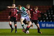 23 October 2021; Rory Gaffney of Shamrock Rovers in action against Aodh Dervin of Longford Town during the SSE Airtricity League Premier Division match between Longford Town and Shamrock Rovers at Bishopsgate in Longford. Photo by Seb Daly/Sportsfile