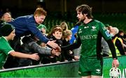 23 October 2021; Mack Hansen of Connacht high fives supporters after the United Rugby Championship match between Connacht and Ulster at Aviva Stadium in Dublin. Photo by Brendan Moran/Sportsfile