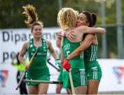24 October 2021; Anna O'Flanagan of Ireland celebrates with team-mate Michelle Carey after scoring her side's first goal during the FIH Women's World Cup European Qualifier Final match between Ireland and Wales at Pisa in Italy. Photo by Roberto Bregani/Sportsfile