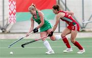 24 October 2021; Sarah Hawkshaw of Ireland in action against Leah Wilkinson of Wales during the FIH Women's World Cup European Qualifier Final match between Ireland and Wales at Pisa in Italy. Photo by Roberto Bregani/Sportsfile
