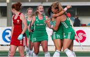 24 October 2021;  Anna O'Flanagan of Ireland is congratulated by her team-mates Zara Malseed, right, and Sarah Hawkshaw, centre, after scoring her side's second goal during the FIH Women's World Cup European Qualifier Final match between Ireland and Wales at Pisa in Italy. Photo by Roberto Bregani/Sportsfile
