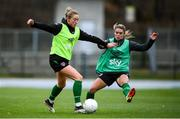 24 October 2021; Megan Connolly is tackled by Jamie Finn, right, during a Republic of Ireland Women training session at Leppavaara Stadium in Helsinki, Finland. Photo by Stephen McCarthy/Sportsfile
