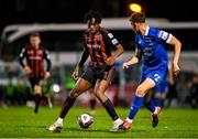25 October 2021; Promise Omochere of Bohemians in action against Jack Stafford of Waterford during the SSE Airtricity League Premier Division match between Bohemians and Waterford at Dalymount Park in Dublin. Photo by Seb Daly/Sportsfile
