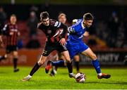 25 October 2021; Dawson Devoy of Bohemians is fouled by Jack Stafford of Waterford during the SSE Airtricity League Premier Division match between Bohemians and Waterford at Dalymount Park in Dublin. Photo by Seb Daly/Sportsfile