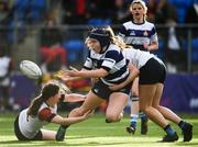 26 October 2021; Amy Lynch of North Midlands is tackled by Siobhan Egan, left, and Georgia Young of Midlands during the Sarah Robinson Cup First Round match between North Midlands and Midlands at Energia Park in Dublin. Photo by David Fitzgerald/Sportsfile