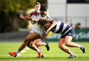 26 October 2021; Faith Odunze of Midlands is tackled by Hannah Wilson of North Midlands during the Sarah Robinson Cup First Round match between North Midlands and Midlands at Energia Park in Dublin. Photo by David Fitzgerald/Sportsfile