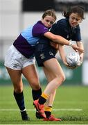 26 October 2021; Grace Adams of Metro is tackled by Robyn O'Connor of South East during the Sarah Robinson Cup First Round match between South East and Metro at Energia Park in Dublin. Photo by David Fitzgerald/Sportsfile