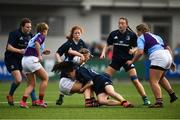 26 October 2021; Jess Reynolds of South East is tackled by Isobel O'Sullivan of Metro during the Sarah Robinson Cup First Round match between South East and Metro at Energia Park in Dublin. Photo by David Fitzgerald/Sportsfile
